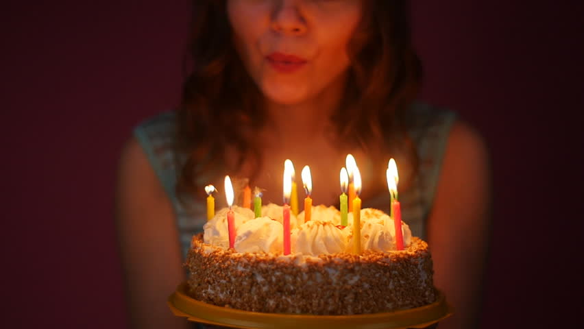 woman-blowing-out-candles