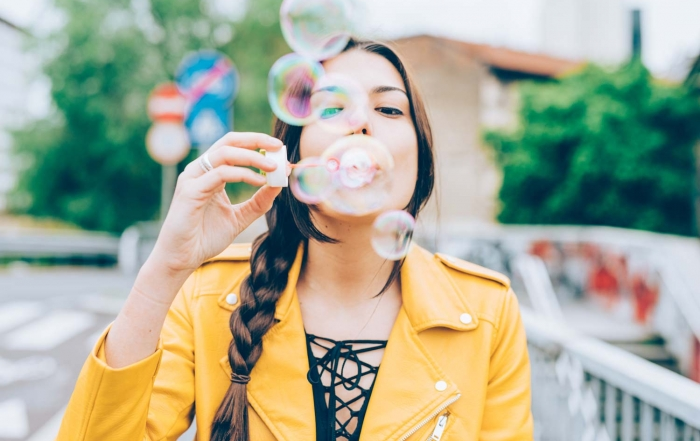woman-playing-with-bubbles