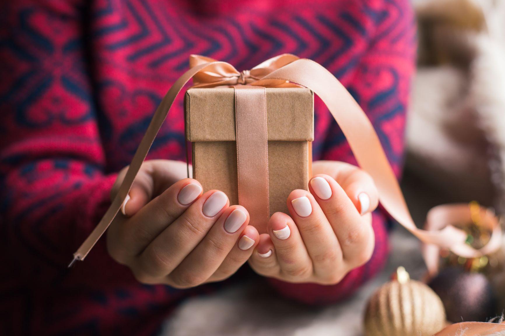 women-holding-gift